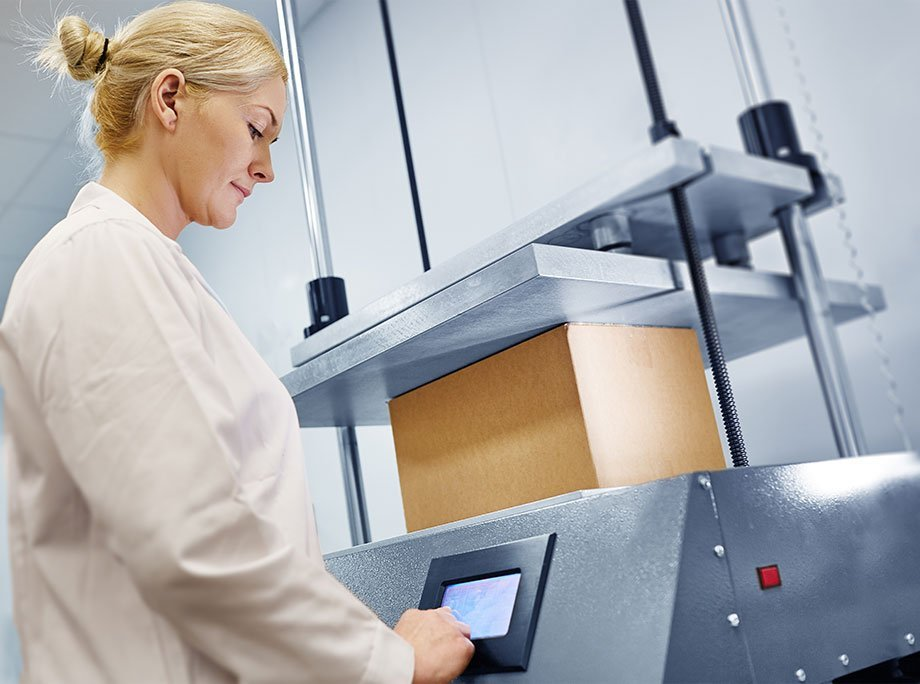 Female Bemis Healthcare Packaging Europe employee carrying out compression-testing