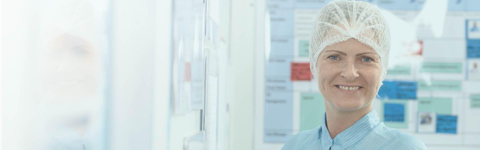 Female Bemis Healthcare Packaging Europe employee with hair net