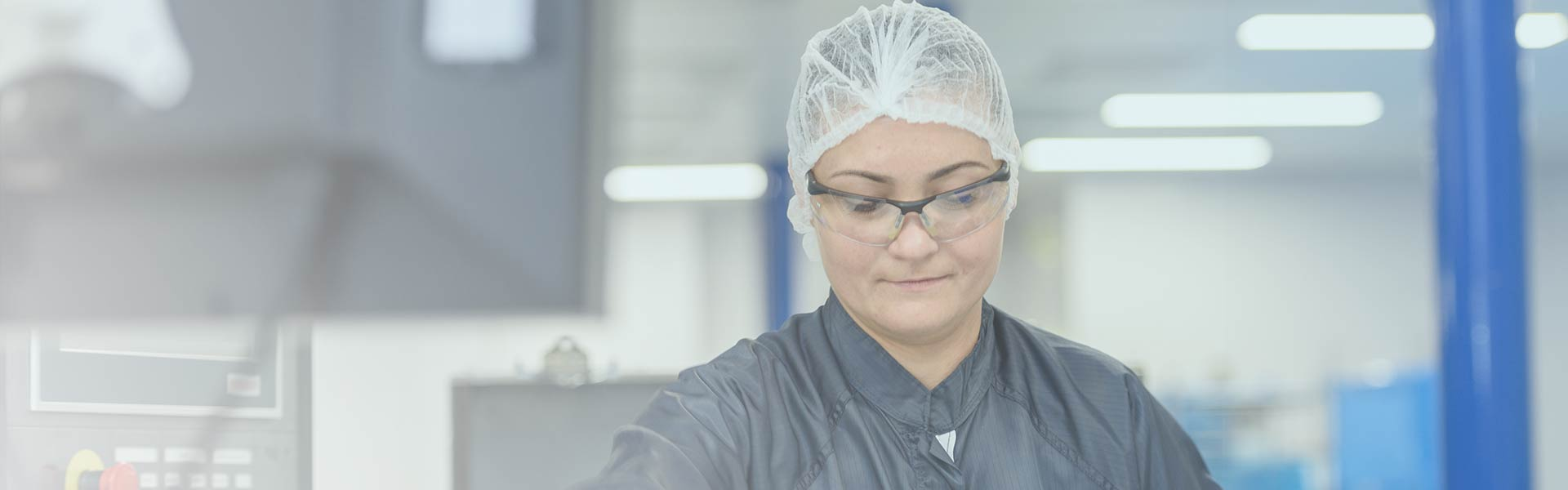 Female Bemis Healthcare Packaging Europe operative with hair net and eye goggles